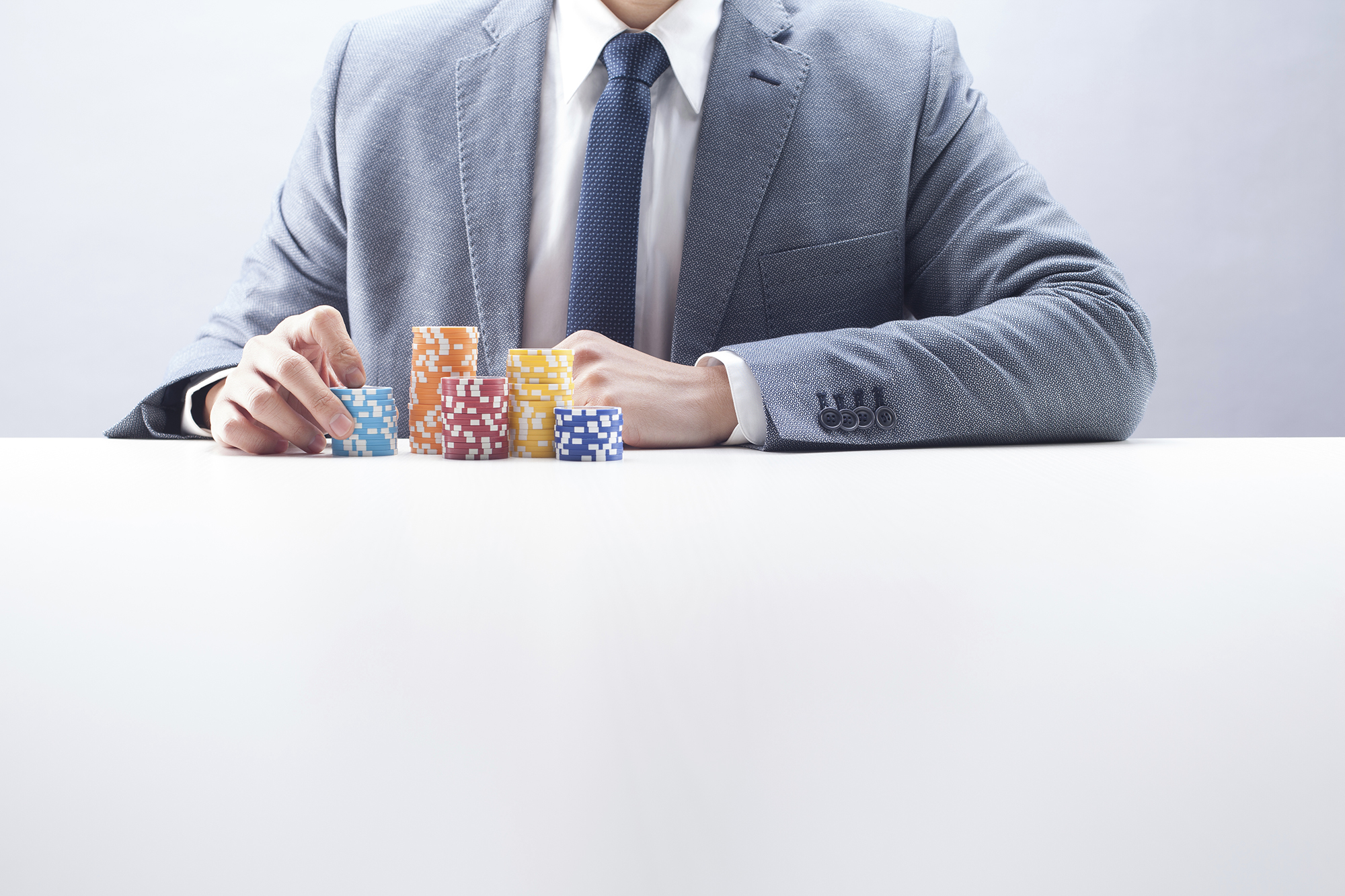 man with poker chips