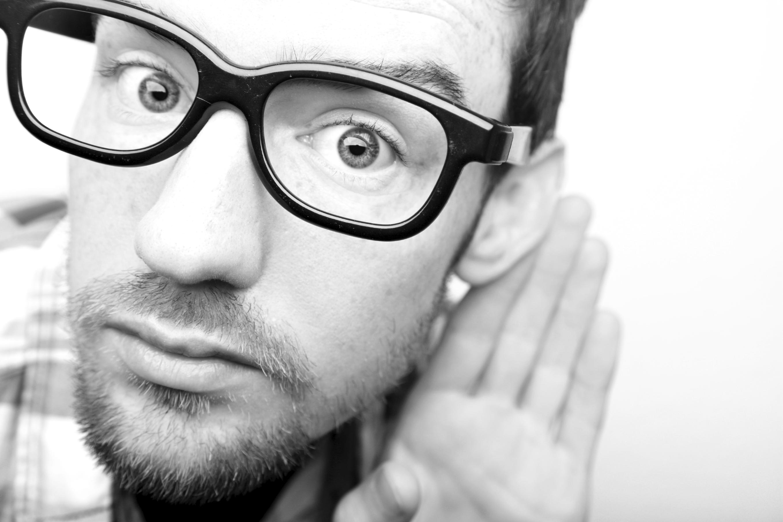 man scruff glasses listening