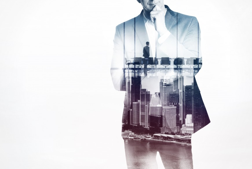 man in business suit tranparent buildings employee thinking talent
