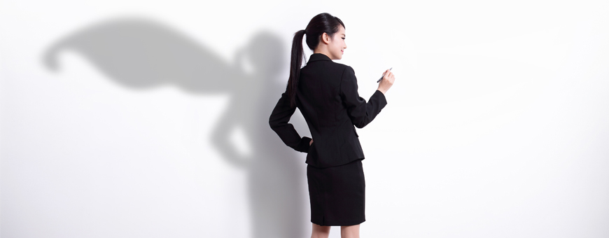 Asian woman employee in black skirt suit with superhero shadow