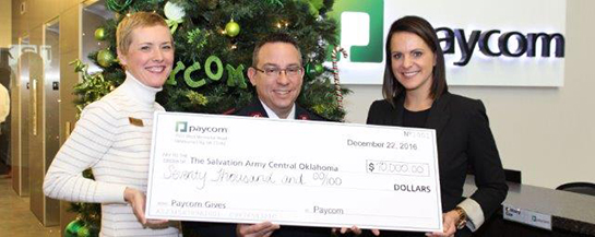 The Salvation Army of Central Oklahoma's Development Director, Traci Jinkens and Area Commander, Major Carlyle Gargis, stand with Paycom COO Stacey Pezold, during the presentation of Paycom's record-breaking $70,000 Red Kettle campaign contribution.